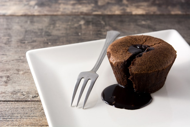 Coulant chocolate cake on wooden table