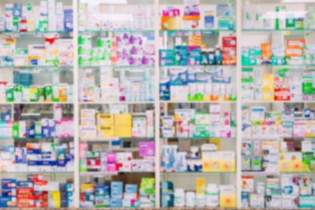 カウンターストアテーブル薬局背景棚ぼやけてぼかしフォーカスドラッグメディカルショップドラッグストア薬空白薬薬。