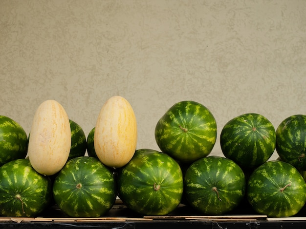 A counter with melons and watermelons. sale of fruits, vegetables and berries, copy space