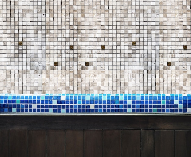 Countertop mosaic tiles and wood caupboard in the kitchen or toilet