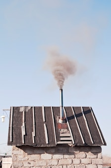 Country bathhouse. the smoke from the chimney