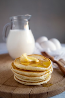Country breakfast, pancakes, milk and eggs. a rustic style.