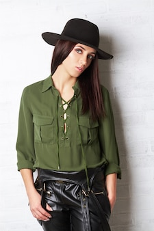 Country girl in the hat and green blouse, portrait