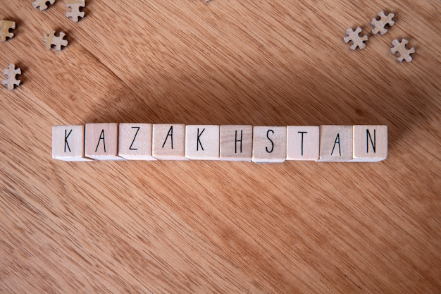 The country kazakhstan written on wooden cubes on wooden background,