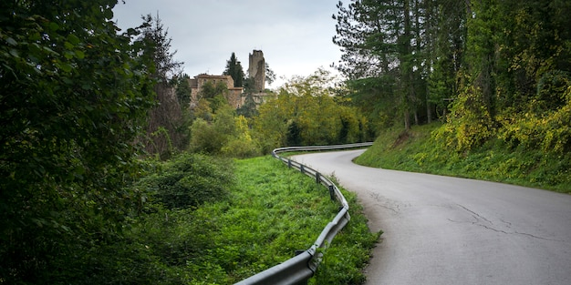 Country road passing through a village, chianti, tuscany, italy