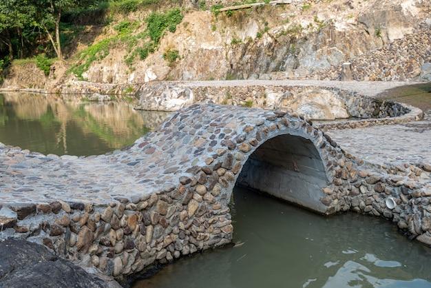 Country scenery, stone bridges and waterwheel