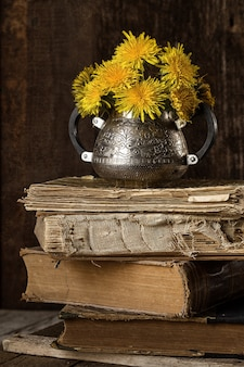 Country still life with bouquet and old things, books,
