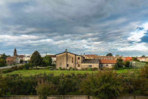 Countryside village cloudy landscape panorama in autumn