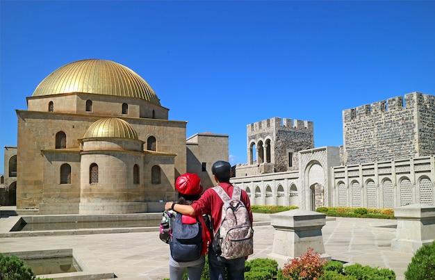 Couple admiring the gorgeous akhmediye mosque inside the rabati castle akhaltsikhe georgia
