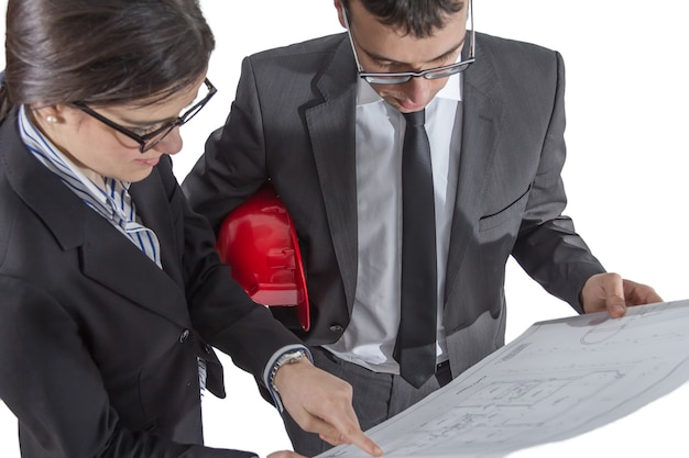 Couple of architects revising a house project plans, isolated on white background