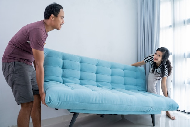 Couple arrange the living room