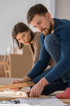 Couple assembling furniture