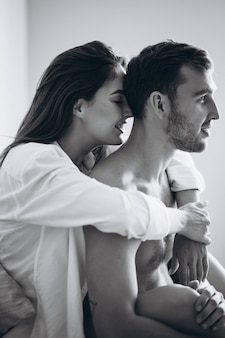 Couple at home embracing