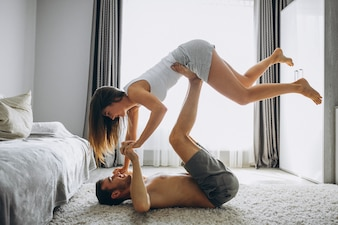 Couple at home lying on floor and exercising