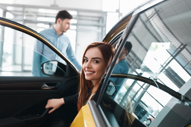 Couple in auto dealership chooses a car