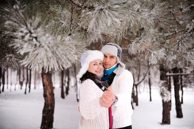 Couple on the background of snowy trees