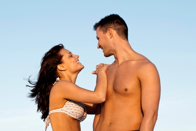 Couple in bathing suits standing together
