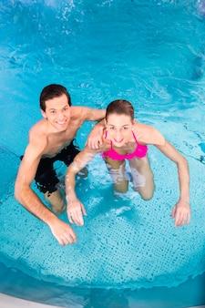 Couple bathing in swimming pool