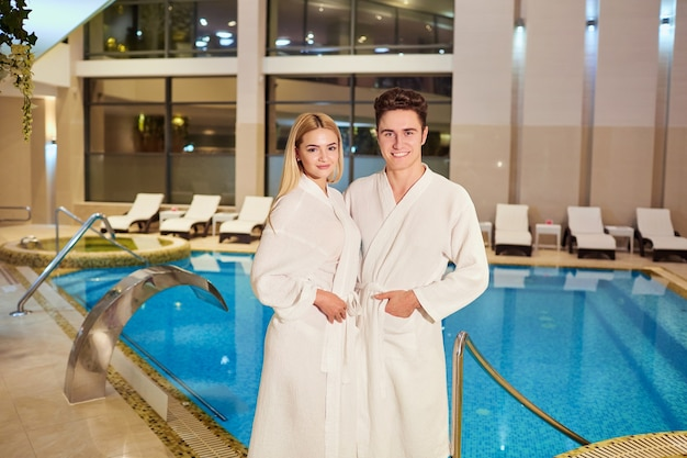 A couple in the bathrobes at the spa