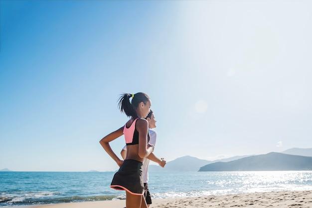 Couple on beach training