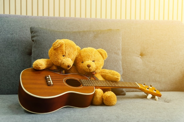 Couple bears playing guitar at home. love concept.