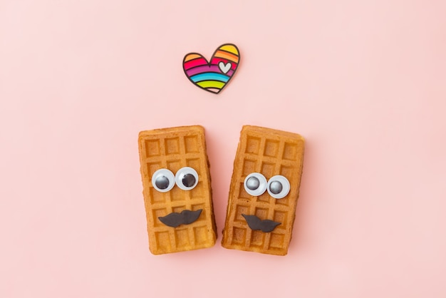 Couple beauty sweet viennese waffles on pink background