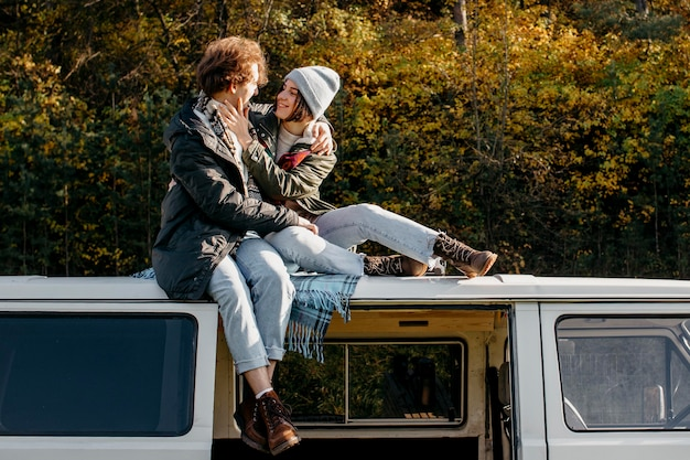 Couple being close while sitting on a van