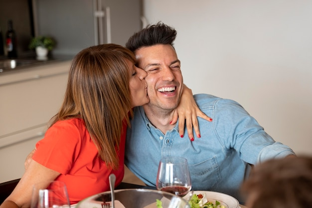 Couple being romantic at family dinner