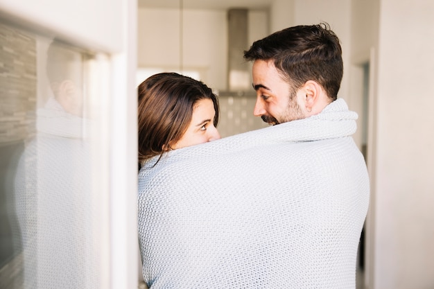 Couple in blanket looking at each other