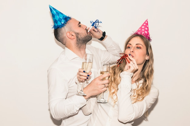 Couple blowing in penny whistles