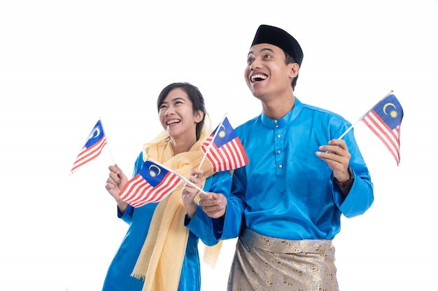 Couple in blue holding malaysian flag
