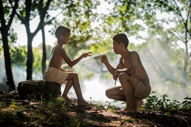 Couple boy playing battle symbol hand native of thailand.lifestyle countryside