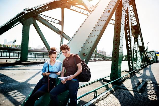 Couple bridge hangout traveling map concept