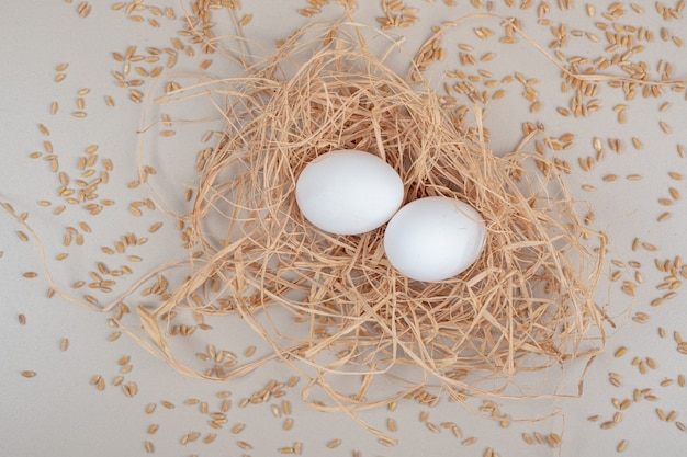Couple brown chicken egg on white surface