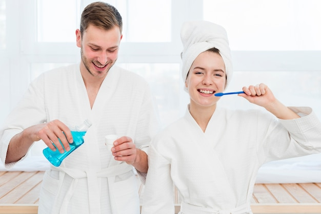 Couple brushing their teeth and using mouthwash