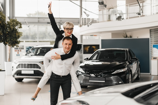Couple buying the car. pair in a car salon choose an automobile