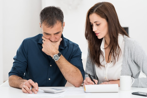 Couple calculating budget