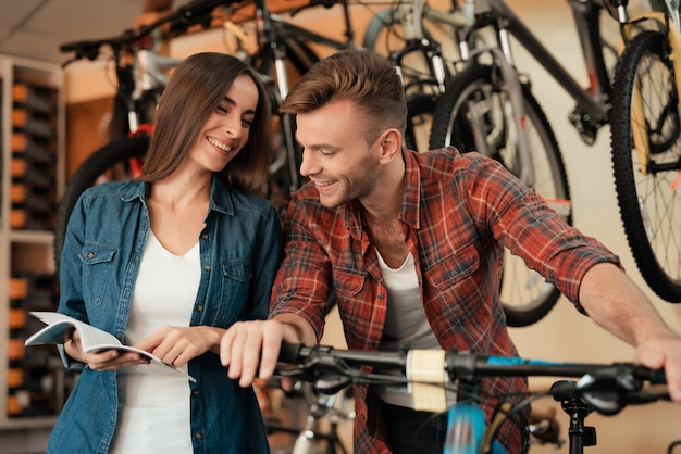 A couple came to the bicycle shop to choose a new bicycle.