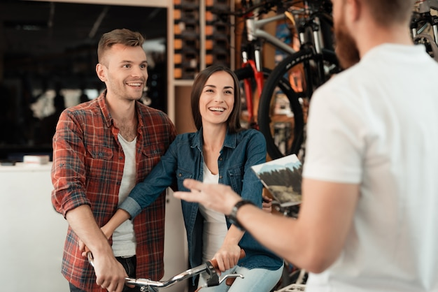 Couple came to the bicycle shop to choose a new bicycle