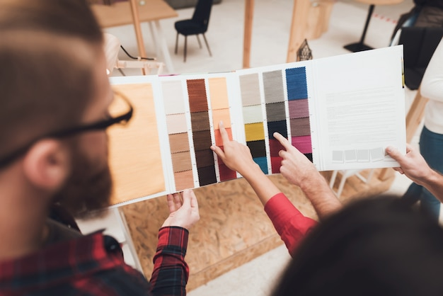 A couple came to choose colors for their furniture.