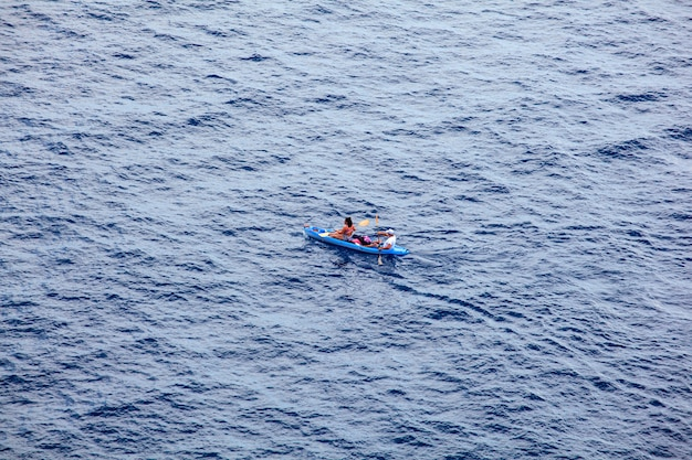 Couple canoeing in the lampedusa sea