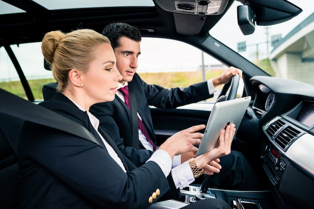 Couple in car being lost navigating with map