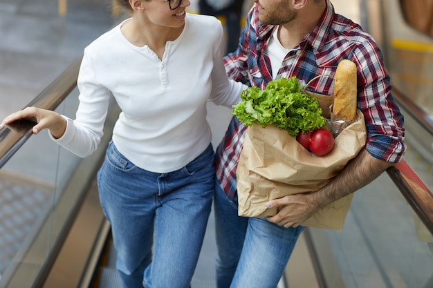 Couple carrying grocery bag