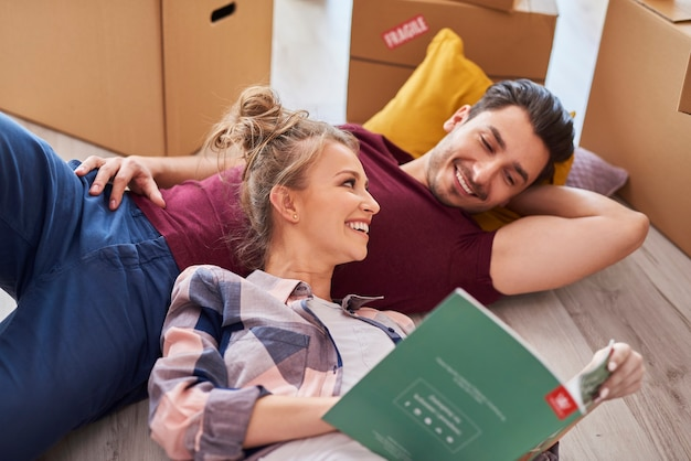 Couple catching a break while moving house