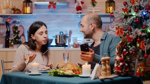 Couple celebrating christmas eve with festive dinner