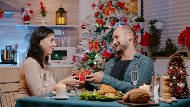 Couple celebrating christmas eve with presents