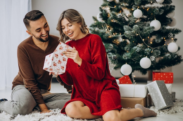Couple celebrating christmas together at home