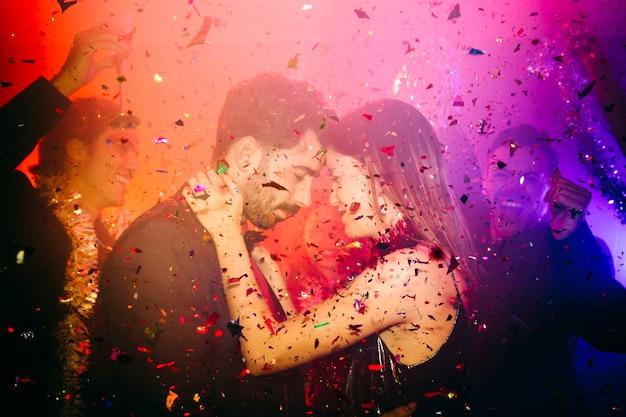 Couple celebrating in club with confetti