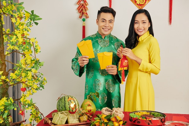 Couple celebrating tet at home