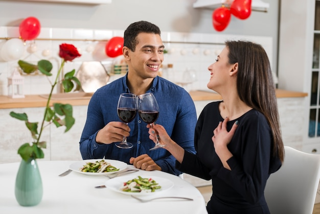 Couple celebrating valentine's day with wine